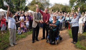Stewart White and Sarah Fincham cutting the ribbon to officially open the Marston Marsh Easy Access Path